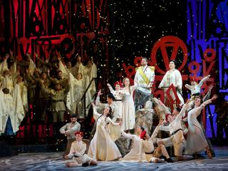 David Pomeroy (Radamès) and Elena Gabouri (Amneris) with cast members of Seattle Opera's Aida. Jacob Lucas photo