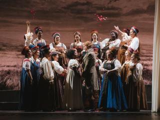 Seattle Opera Chorus, Melody Wilson (Olga) and Colin Ainsworth (Lensky). Sunny Martini photo.