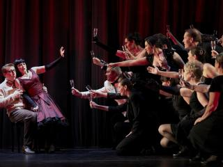 "Joshua Dennis (Alfredo), Corinne Winters (Violetta) and cast members of Seattle Opera's ""La traviata."" Philip Newton photo"